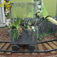 Оригинальная идея Южноафриканского общества любителей орхидей на выставке WOC 21 разместить орхидеи в вагонетках, символизирующих основную горнодобывающую отрасль страны